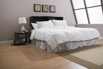 hardwood floors complement this loft style bedroom - Decorate Bedrooms