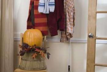 A properly hung coat rack can support the weight of heavy jackets.