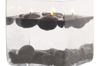 Candles, stones or other natural elements fill glass vase centerpieces for interesting displays.