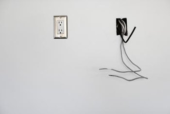 Remove all the wires before covering an outlet box with drywall.