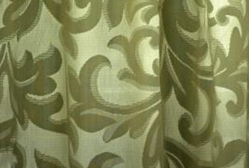Sage green curtains provide a soft, neutral accent.