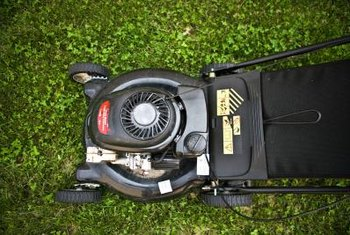 The flywheel can be removed from beneath the lawn mower's upper shroud.