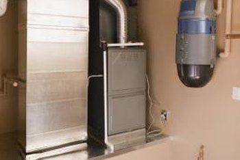 The central heat unit sits next to the ductwork in this home's basement.