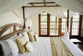 Retrofit a gazebo frame to surround your bed with fabric.