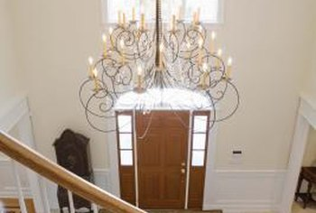 Hang the chandelier in the center of the window in the foyer.