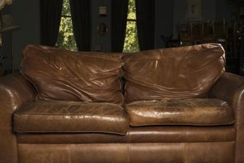 Pillows, rugs and accessories help integrate both new and well-worn leather sofas into your living room.