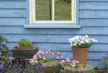 Add interest to your shaded flower bed by including other elements.