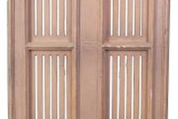 Custom shutters should follow the shape of the window's arched center section.