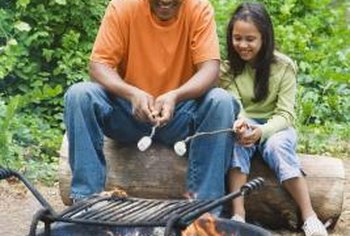A dug-in firepit and barbecue grill enhances your backyard activities.