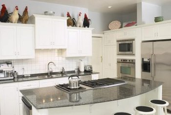 All-white cabinets and rooster decor, popular in the 1940s, find a place in modern interiors.