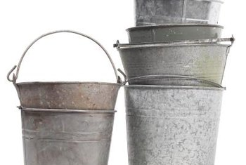 Shiny or with a patina, galvanized metal buckets provide gardening space.