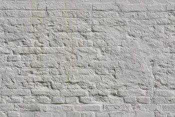 Removing paint from brick can restore the original look but is not a quick task. Brick is porous