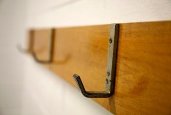 Metal hardware braces, screwed into the bottom frame of a bulletin board, make key-catchers.