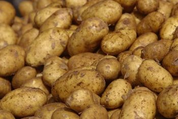 Remove soil from potatoes before curing them.