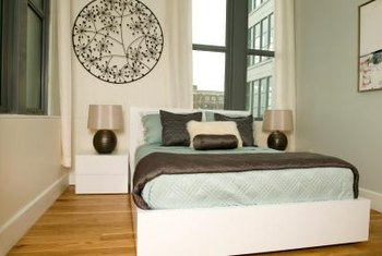 asymmetry is fine as long as you achieve visual balance - Long Bedroom Design