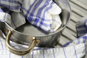 Keep your pots and pans sparkling clean with vinegar and cream of tartar.