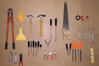 Pegboards can help to keep tools neatly arranged.