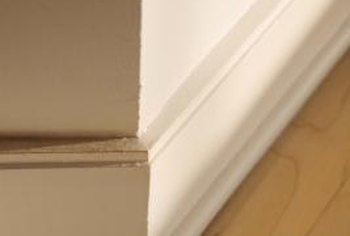 Dirt and dust can collect in the decorative lines of a wood baseboard.