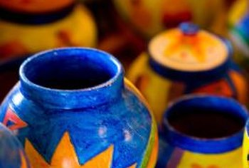 Brightly painted vases are perfect for a Spanish-themed centerpiece.