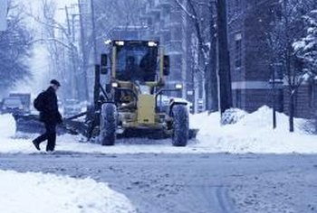 Winter road crews are more worried about driver safety than your lawn.