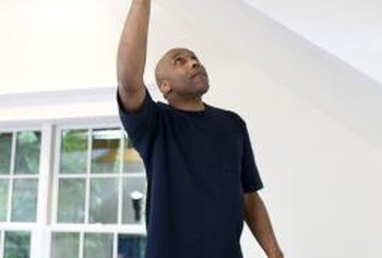 Painting over water spots can improve the appearance of your ceiling.