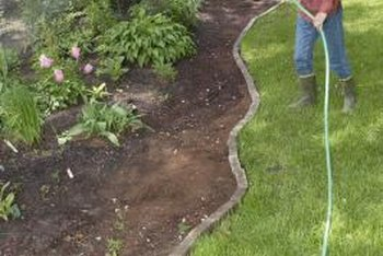 Drip irrigation systems help you water those hard-to-reach garden areas.