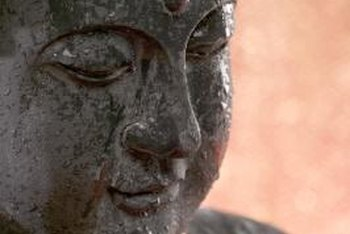 Install a Buddha statue in the garden as a reminder of simplicity.