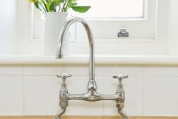 A basin wrench simplifies kitchen faucet removal.