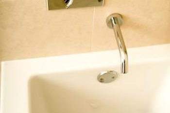 You must set your bathtub level in order for it to drain properly.