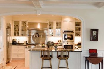 Light colors, glass cabinet doors and simple furnishings suggest unadorned cottage style.