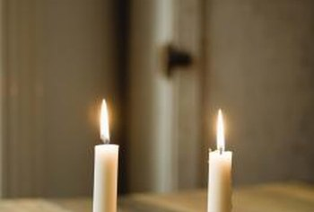 Candles tied with bows make festive and inexpensive decorations.