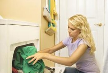 A dryer that tumbles but does not blow hot air likely has a faulty thermostat.