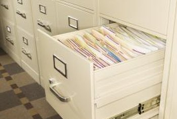 File cabinet drawers use side-mount runners with safety locks.