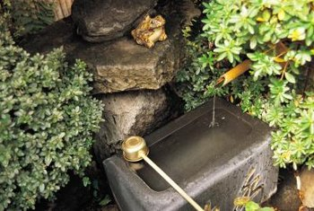 Tuck a garden fountain into a flowerbed to add a focal point.