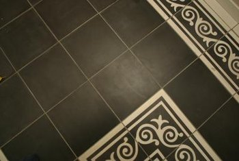 Artistic tile bathroom floors lend to the feel of a Craftsman home.