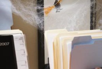 Paper serves as a kid-friendly craft supply for homemade Halloween decorations.
