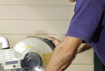 Professionals use a power miter saw to cut window casing.