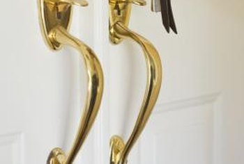 Brass-plated door handles can make a door look outdated.