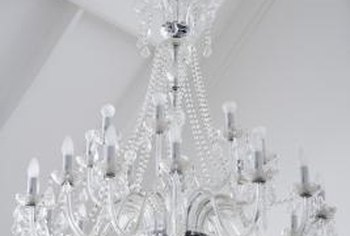 Distress a new chandelier to create a shabby chic look.