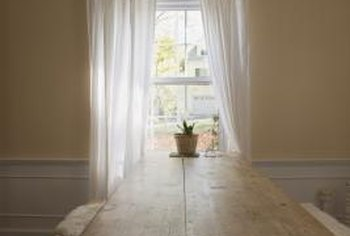Dress up a drab tab curtain with a valance set the right way.