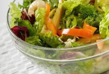 Make a seafood salad with prawns and greens.