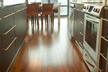 The contrast of a darker wood floor will help oak cabinets stand out in your home.