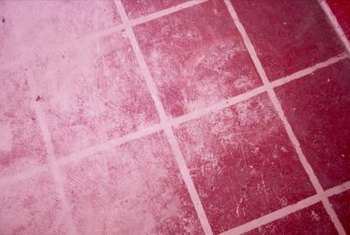 Once dried, grout is hard and appears porous.