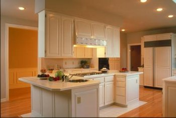 Painted cabinets can lighten the kitchen by unifying surfaces.