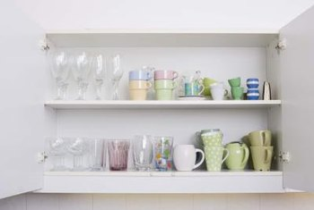 Upper kitchen cabinets may just be deep enough to hold mugs and glasses.