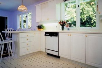 Clean and paint and upgrade kitchen cabinets to transform their appearance and function.