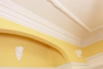 Architectural crown molding is installed on the ceiling.