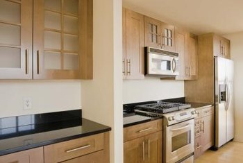 If you kitchen is very narrow, it's best to place the fridge, range and sink on the same wall.