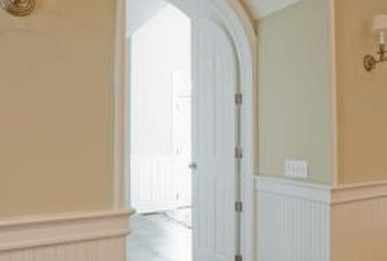 Adding arched doorways as an architectural design element infuses a room with flair.