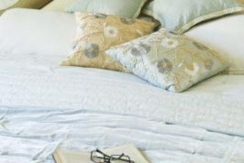 Give an ugly comforter a makeover with dye, paint or fresh fabric.